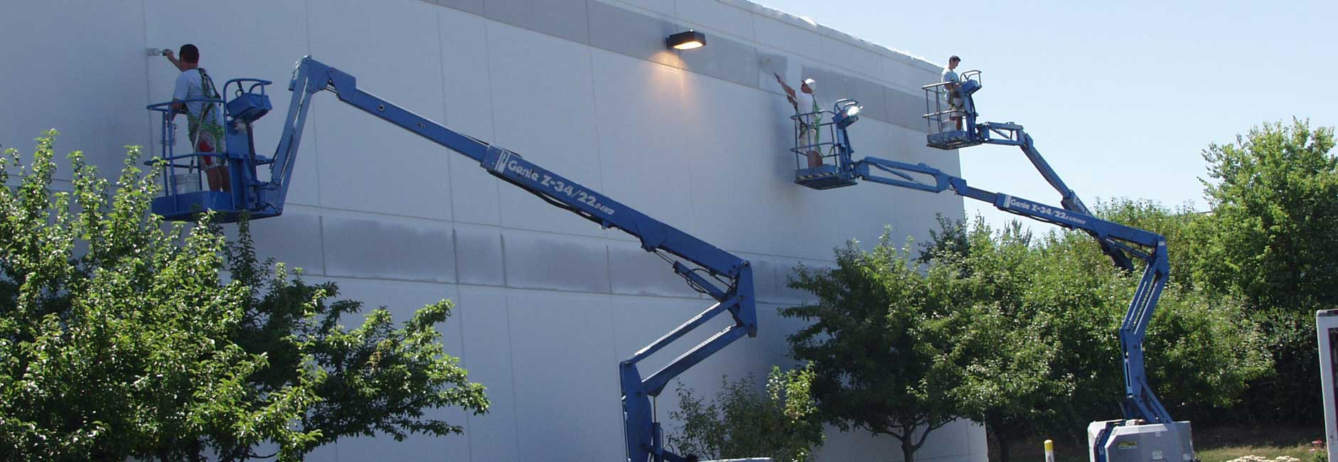 Commercial Painters On Lift